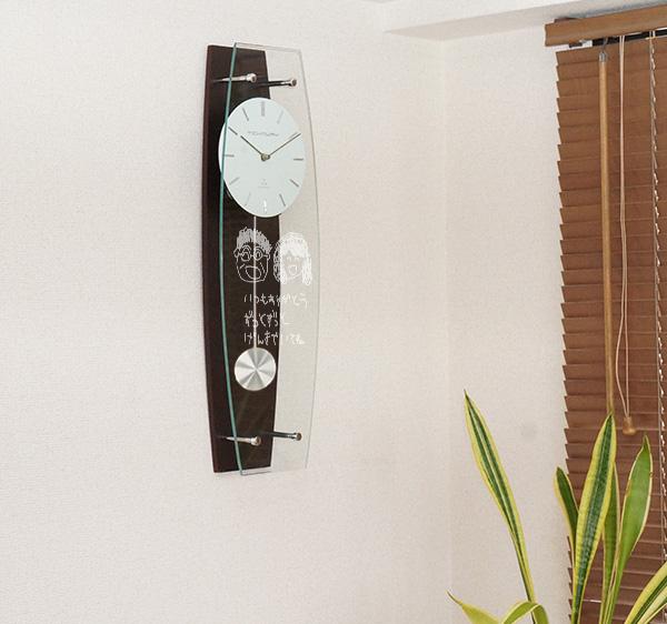 退職祝いにお子様が描いた似顔絵時計のプレゼント